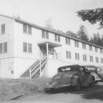 Redwood_Hall_mens_dorm,_HSC,_1948._Fisheries_Hut_at_far_end_._.jpg